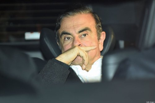 Former Nissan chairman Carlos Ghosn leaves his lawyers' offices after he was released earlier in the day from a detention centre after posting bail in Tokyo on March 6, 2019 [KAZUHIRO NOGI/AFP via Getty Images]