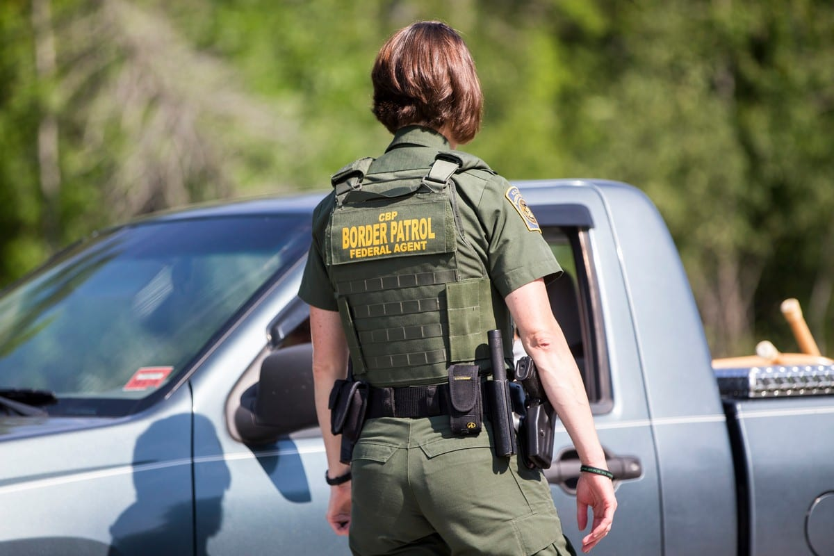 A US Border Patrol agent questions a driver near the US and Canada border [Scott Eisen/Getty Images}