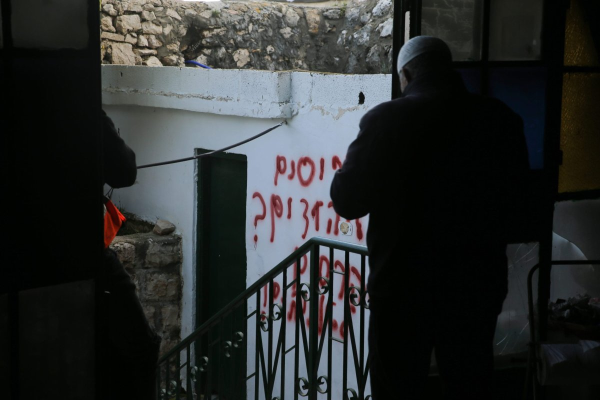 Racial slurs on the wall of a mosque sprayed by Jewish settlers in Jerusalem on 24 January 2020 [Mostafa Alkharouf/Anadolu Agency]