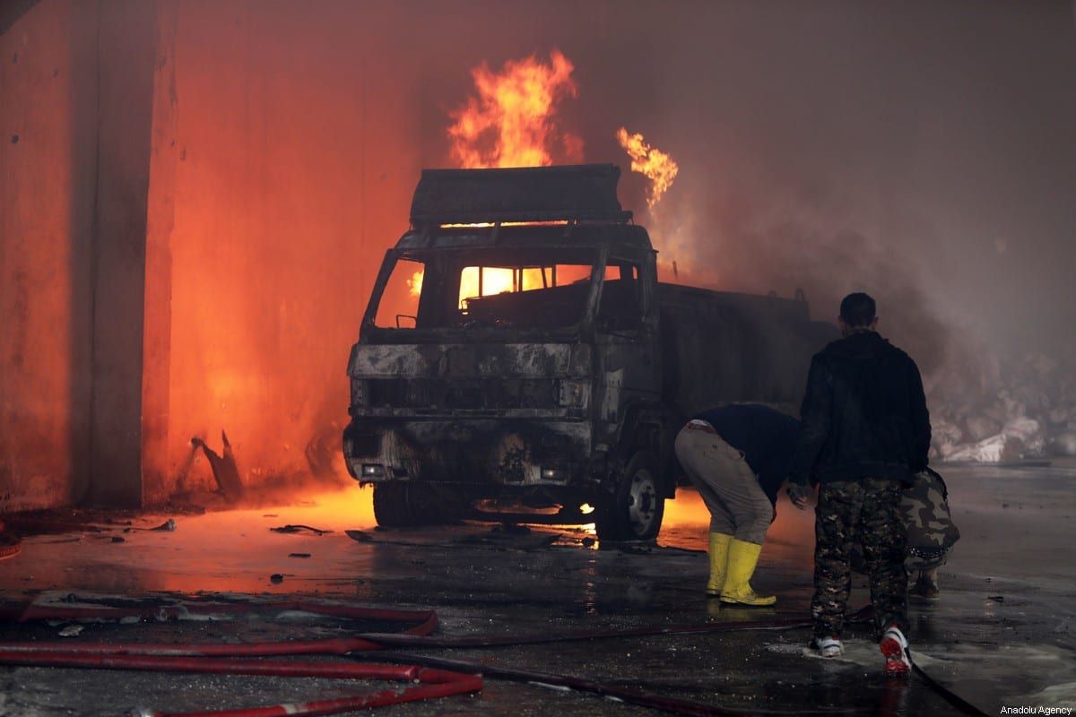 Firefighters try to extinguish fire broke out after a bomb-laden vehicle exploded in Tal Abyad, Syria on 30 January 2020. [Bekir Kasim - Anadolu Agency]