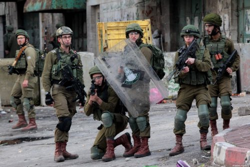 Israeli forces take aim at Palestinians during a protest against US President Donald Trump's Middle East plan in Hebron, West Bank on January 31, 2020 [Mamoun Wazwaz / Anadolu Agency]