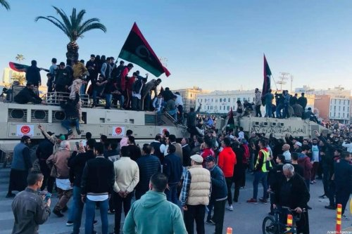 People stage a protest against Libya's renegade commander Khalifa Haftar as they climb on a Haftar's armored vehicle seized by The Government of National Accord (GNA) at Martyrs' Square in Tripoli, Libya on 31 January 2020. [BURKAN AL GHADAN OPERATION PRESS OFFICE / HANDOUT - Anadolu Agency]