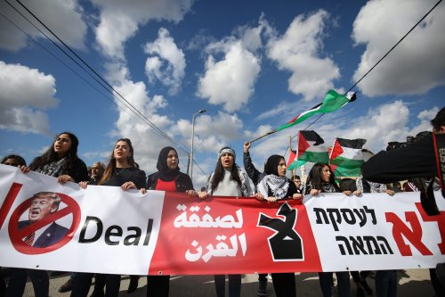 Palestinians holding flags of Palestine, march to protest against US President Donald Trump's so-called Middle East peace plan on 1 February 2020 [Mostafa Alkharouf/Anadolu Agency]
