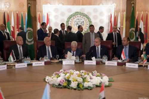 Secretary-General of Arab League Ahmed Aboul Gheit (L), Secretary-General of Palestine Liberation Organisation's (PLO) Executive Committee, Saeb Erekat (2nd L), Palestinian President, Mahmoud Abbas (C) and Iraqi Foreign Minister Mohamed Ali Alhakim (2nd R) attend an Arab League Foreign Ministers' extraordinary meeting on US President Donald Trump's so-called Middle East peace plan in Cairo, Egypt on February 1, 2020 [Thaer Ghanaim / Palestinian Presidency / Handout - Anadolu Agency]