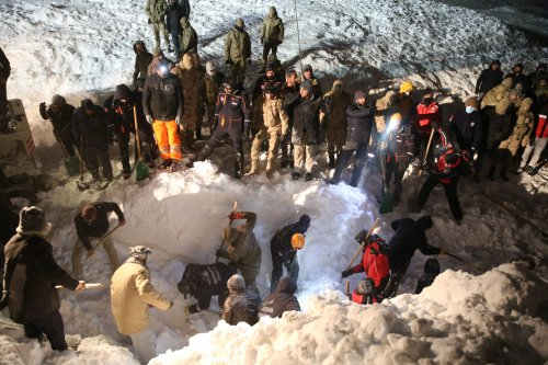 Search and rescue works continue at site to find a construction equipment and a van, which have been buried under avalanche with passengers, at Van-Bahcesaray highway in Van, Turkey on 4 February, 2020 [Özkan Bilgin/Anadolu Agency]