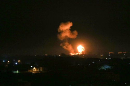Smoke rises and explosion illuminates the night sky after Israel launched airstrikes targeting positions of the Izz ad-Din al-Qassam Brigades, Hamas' military wing in Khan Yunis, Gaza on 5 February, 2020 [Abed Rahim Khatib/Anadolu Agency]