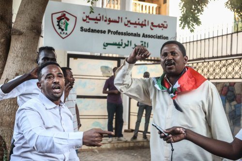 """Dozens of members of the """"Resistance Committees"""" of revolutionary Sudanese youth gather to a protest against meeting of Sudan's Sovereign Council Head Abdel-Fattah al-Burhan and Prime Minister of Israel Benjamin Netanyahu in Uganda, in front of the Union of Sudan Professional Chambers (SPA) headquarters in Khartoum, Sudan on 6 February, 2020 [Mahmoud Hjaj/Anadolu Agency]"""