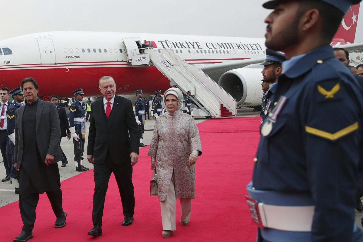 President of Turkey Recep Tayyip Erdogan and his wife Emine Erdogan are welcomed by Pakistani Prime Minister Imran Khan upon their arrival in Islamabad, Pakistan on February 13, 2020 [Murat Kula / Anadolu Agency]