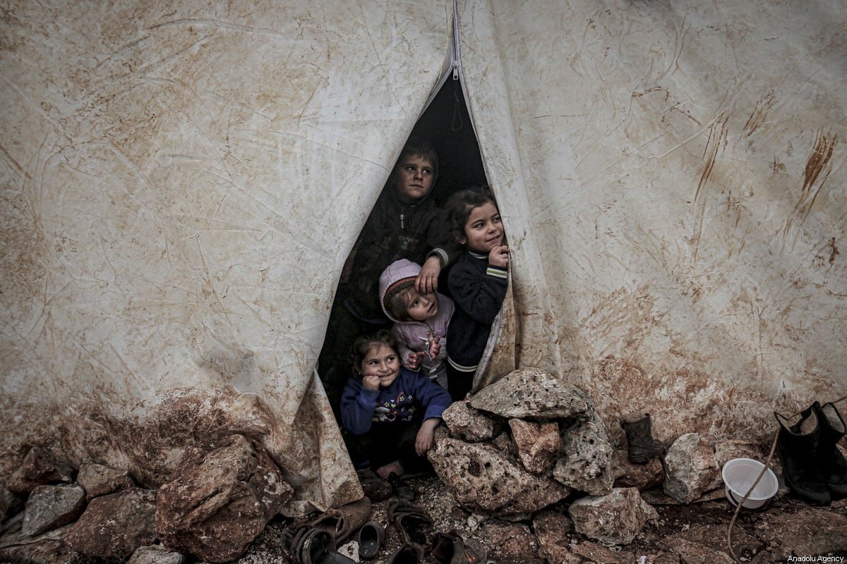 Children of Syrian families, who have been forcibly displaced are seen at a camp in Idlib, Syria on 14 February 2020 [Muhammed Said/Anadolu Agency]