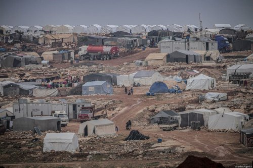 General view of a makeshift camp populated by Syrian families, who have been forcibly displaced due to the ongoing attacks carried out by Assad regime and its allies, in Turmanin in the western rural of Aleppo near Turkish border on a cold winter day in Idlib, Syria on February 14, 2020. ( Muhammed Said - Anadolu Agency )