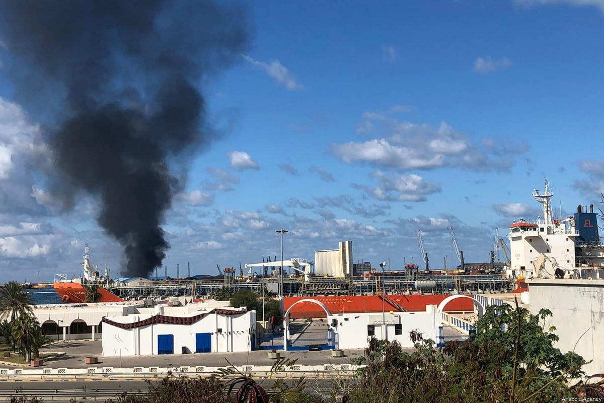 Smoke rises after warlord Khalifa Haftar's forces launched an attack on a port near the Martyrs' Square, where celebration events marking the 9th anniversary of February 17 revolution are held, in eastern Tripoli, Libya on 18 February 2020. [Aydoğan Kalabalık - Anadolu Agency]