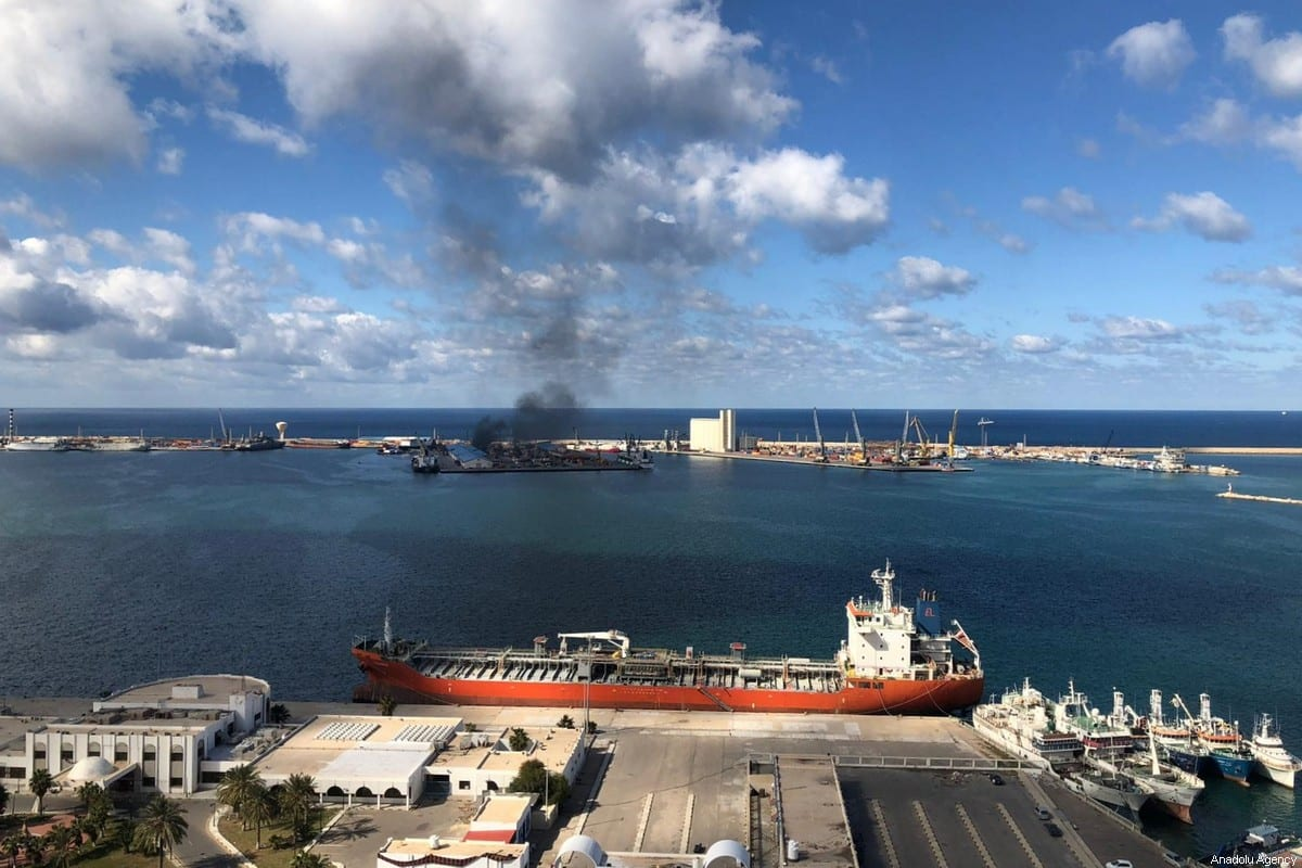 Smoke rises after Khalifa Haftar's forces launched an attack on a port near the Martyrs' Square, where celebration events marking the 9th anniversary of February 17 revolution are held, in eastern Tripoli, Libya on February 18, 2020 [Aydoğan Kalabalık / Anadolu Agency]