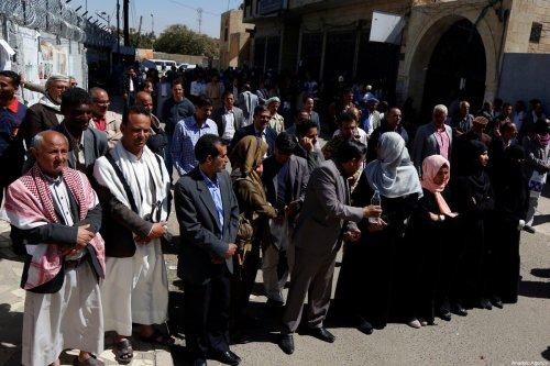 People gather in front of United Nation's office in Sanaa to stage a protest against airstrike carried out by war planes of coalition forces led by Saudi Arabia over Al Jawf, in Sanaa, Yemen on 9 February 2020. [Mohammed Hamoud - Anadolu Agency]
