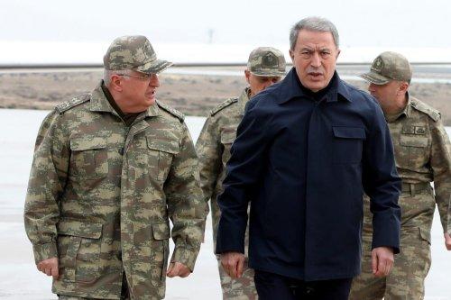 Turkey's Defense Minister, Hulusi Akar (2nd L), Chief of General Staff Gen. Yasar Guler (L), Army Forces Commander Gen. Umit Dundar (R) visit the Syrian border in Hatay, Turkey on 21 February 2020. [Arif Akdoğan - Anadolu Agency]