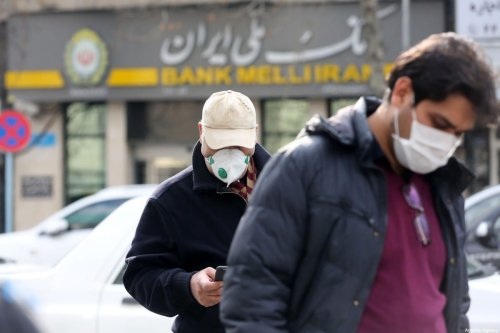 People wear masks after deaths from and new cases of the coronavirus are confirmed in Tehran, Iran on February 21, 2020 [Fatemeh Bahrami / Anadolu Agency]