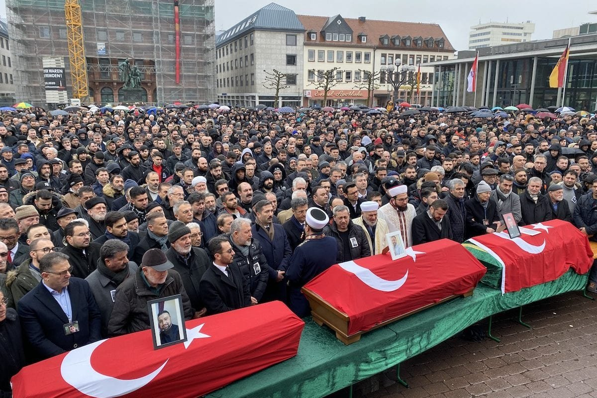 People attend the funeral ceremony held at Marktplatz for Gokhan Gultekin, Sedat Gurbuz and Fatih Saracoglu who died in the racist attack of the far-right extremist in a shooting spree in western town of Hanau, Germany on 24 February 2020. [Mesut Zeyrek - Anadolu Agency]