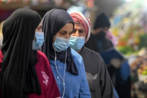 People wear medical masks as a precaution against coronavirus, officially known as COVID-19, on 26 February 2020 in Kuwait city, Kuwait. [Jaber Abdulkhaleg - Anadolu Agency]