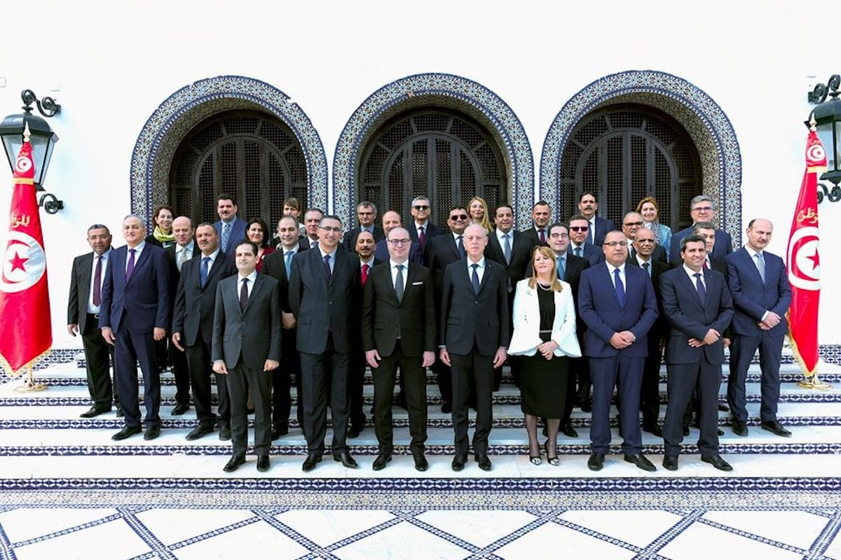 Prime Minister Elyes Fakhfakh (left 3), Tunisian President Kais Saied and cabinet members pose for a photograph during sworn in ceremony in Tunis, Tunisia on 27 February 2020. [Tunisian Presidency / Handout - Anadolu Agency]