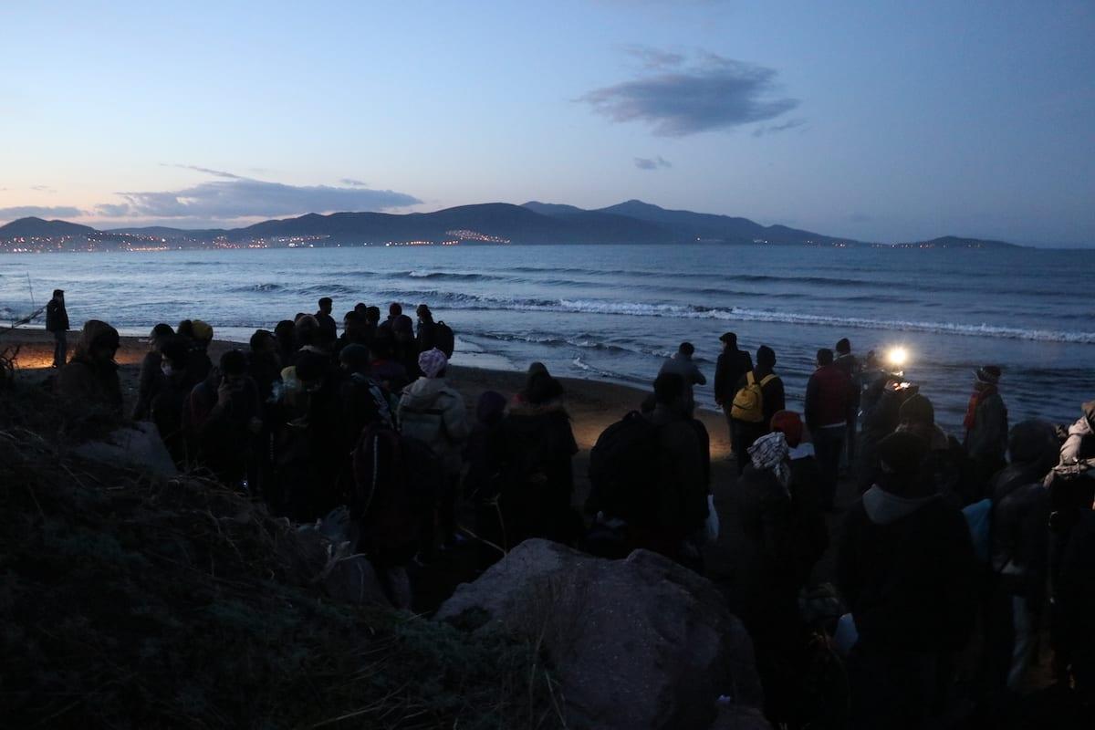 Migrants seen at a beach in Izmir, preparing to set sail for Greek islands, in Izmir, Turkey on February 28, 2020 [Yusuf Soykan Bal / Anadolu Agency]