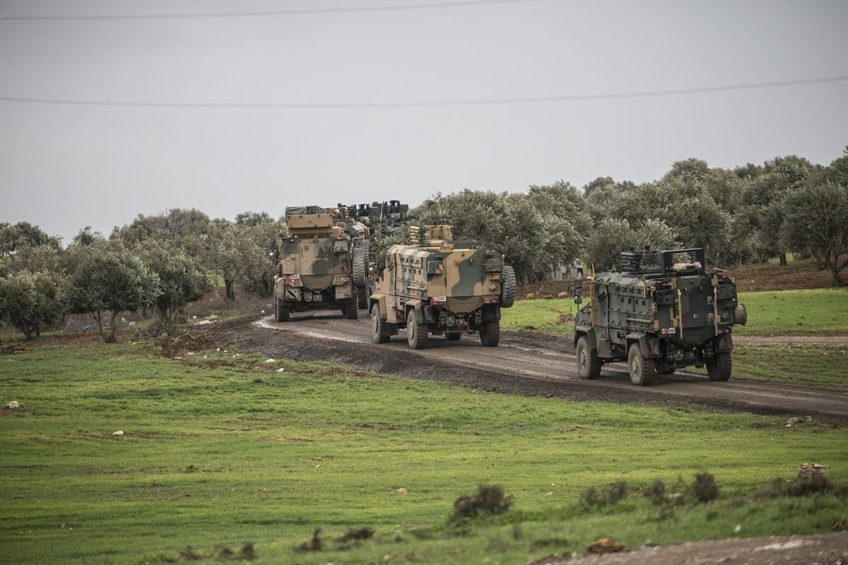 A photo taken from Turkey's Hatay province shows Turkish military convoy consisting of armored personnel carriers are on the way towards observation points in Syria's Idlib, on 7 February 2020 in Hatay, Turkey. [Cem Genco - Anadolu Agency]