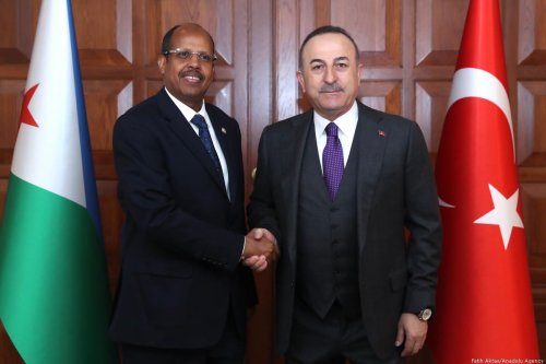 Turkish Foreign Minister Mevlut Cavusoglu and Djibouti's Foreign Minister Ilyas Moussa Dawaleh pose for a photo during a land swap protocol signing ceremony held for the Embassies in Ankara, Turkey on 19 February 2020. [Fatih Aktaş - Anadolu Agency]