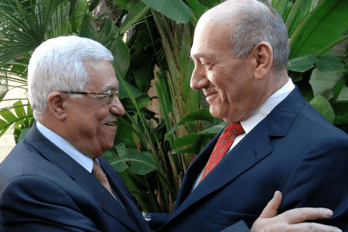 President of the Palestinian Authority, Mahmoud Abbas (L) and Former Prime Minister of Israel, Ehud Olmert (R) [Twitter]