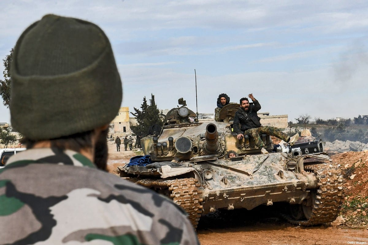 Syrian government soldiers sit atop a tank driving in the village of Khan Tuman, about 17 kilometres southwest of the northern city of Aleppo, on February 1, 2020 [Stringer / AFP via Getty Images]