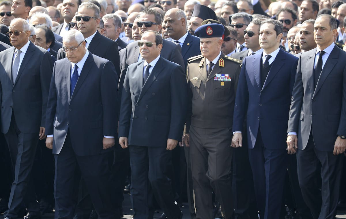 Egyptian President Abdel Fattah al-Sisi (C), former interim president Adly Mansur (2nd L) and the sons of of Egypt's former president Hosni Mubarak, Alaa (2nd R) and Gamal (R), attend Mubarak's funeral ceremony at Cairo's Mosheer Tantawy mosque in the eastern outskirts of the Egyptian capital before the funeral on 26 February 2020. [KHALED DESOUKI/AFP via Getty Images]