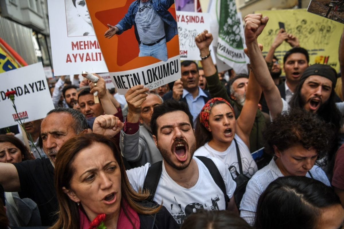 People demonstrate, shouting slogans and holding pictures of Gezi Park victims, on May 31, 2018 in Istanbul, to mark the fifth anniversary of the start of the Gezi Park protests. sues concerning perceived infringements of civil rights. [OZAN KOSE/AFP via Getty Images]
