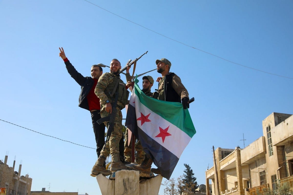 The Syrian National Army flag is raised after the Syrian opposition forces liberated the town of Saraqeb in Idlib governorate on 27 February 2020 [Twitter]