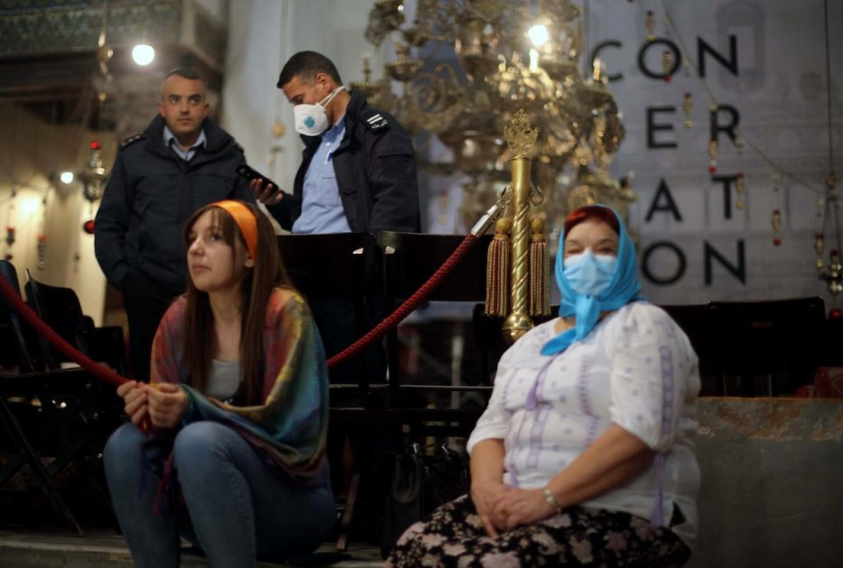 Foreign tourists wearing masks as a preventive measure against the coronavirus visit the Church of the Nativity, in the West Bank city of Bethlehem on 5 March, 2020 [Abedalrahman Hassan/Apaimages]