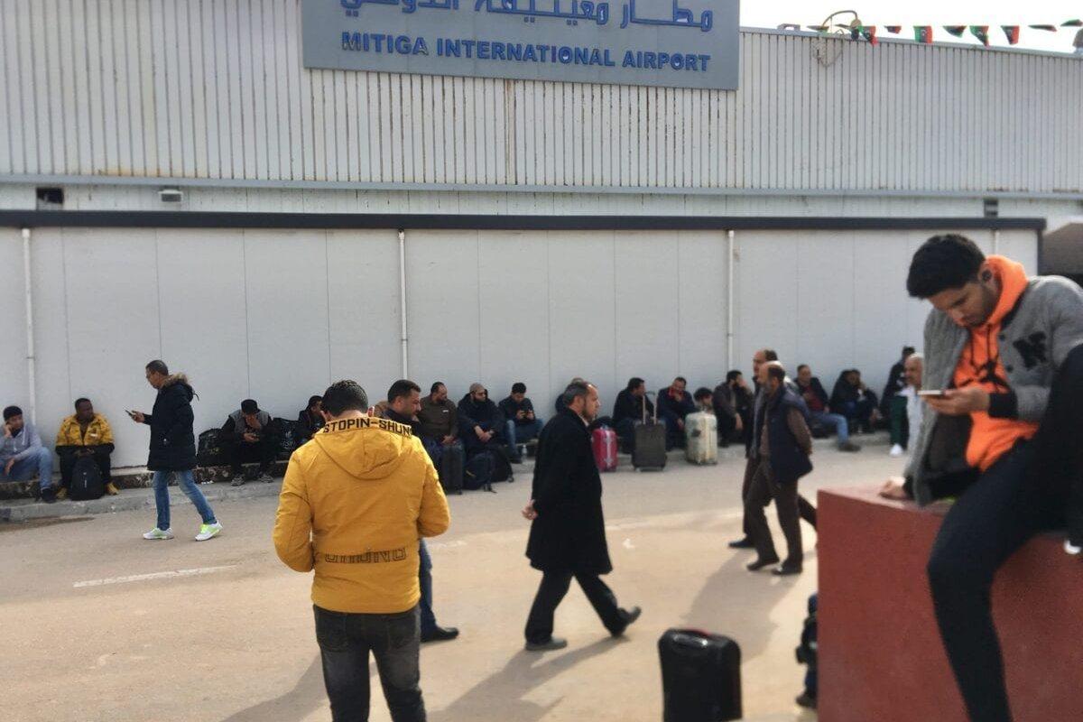 People wait in front of Mitiga International Airport after aviation was suspended following militias loyal to Libyan warlord Khalifa Haftar targeted Mitiga International Airport in the capital Tripoli, Libya on 27 February 2020. [Hazem Turkia - Anadolu Agency]