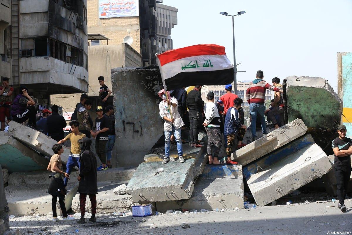 Iraqi demonstrators gather for the anti-government protest at Al-Khulani Square in Baghdad, Iraq on 29 February, 2020 [Murtadha Al-Sudani/Anadolu Agency]