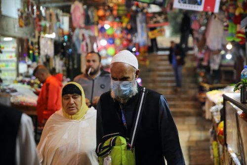 People wear masks to protect themselves from coronavirus (Covid-19) in East Jerusalem on 6 March 2020. [Mostafa Alkharouf - Anadolu Agency]