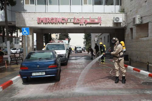 Disinfection works are being carried out by civil defense officials wearing protective suits, at streets, bus stations, hospitals, museums, as precautions taken against coronavirus (COVID 19) on 12 March 2020 in Ramallah, West Bank. [Issam Rimawi - Anadolu Agency]