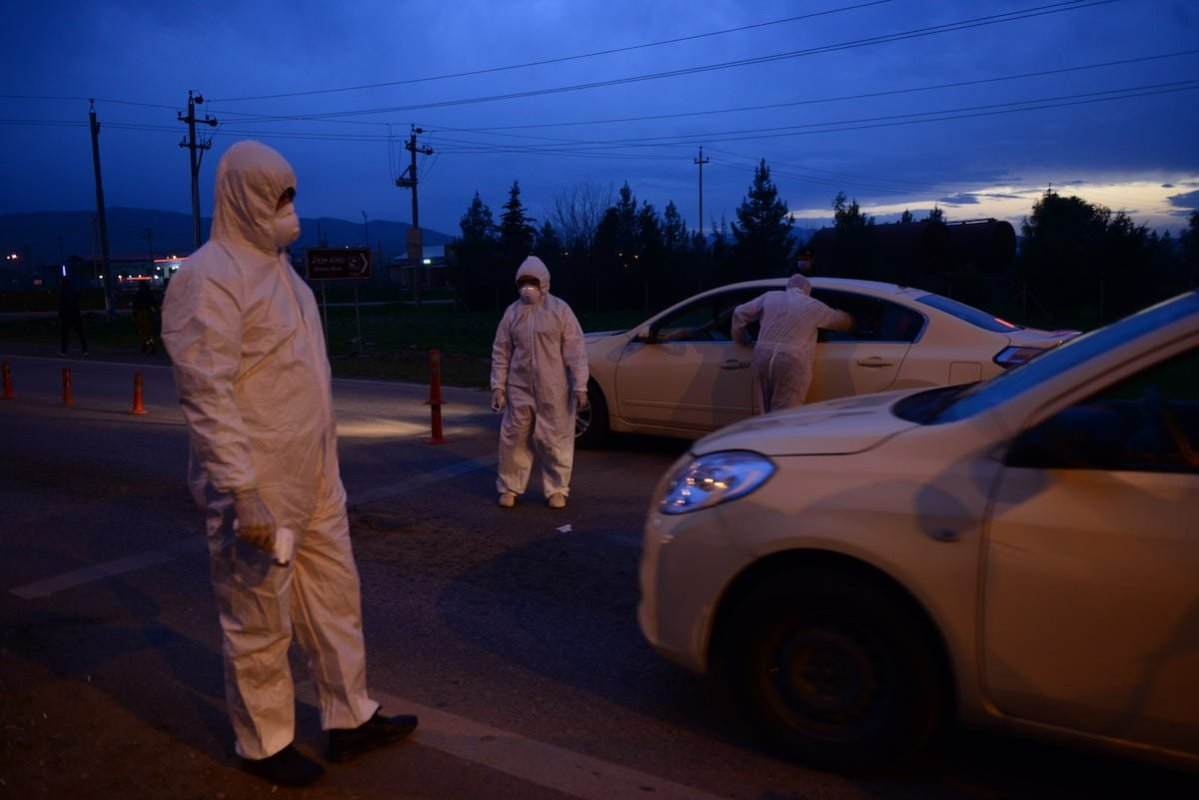 Members of the Ministry of Health of Iraqi Kurdish Regional Government (IKRG) controls set obstacles on the highway between Sulaymaniyah and Halabja to monitor drivers' body temperature within the coronavirus precautions (COVID-19) in Sulaymaniyah, Iraq on 13 March 2020. [Fariq Faraj Mahmood - Anadolu Agency]