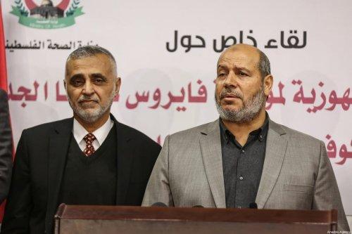 Hamas official Khalil al-Hayya (R) holds a press conference over the precautions against coronavirus (Covid-19) in Gaza City, Gaza on 14 March 2020. [Mustafa Hassona - Anadolu Agency]