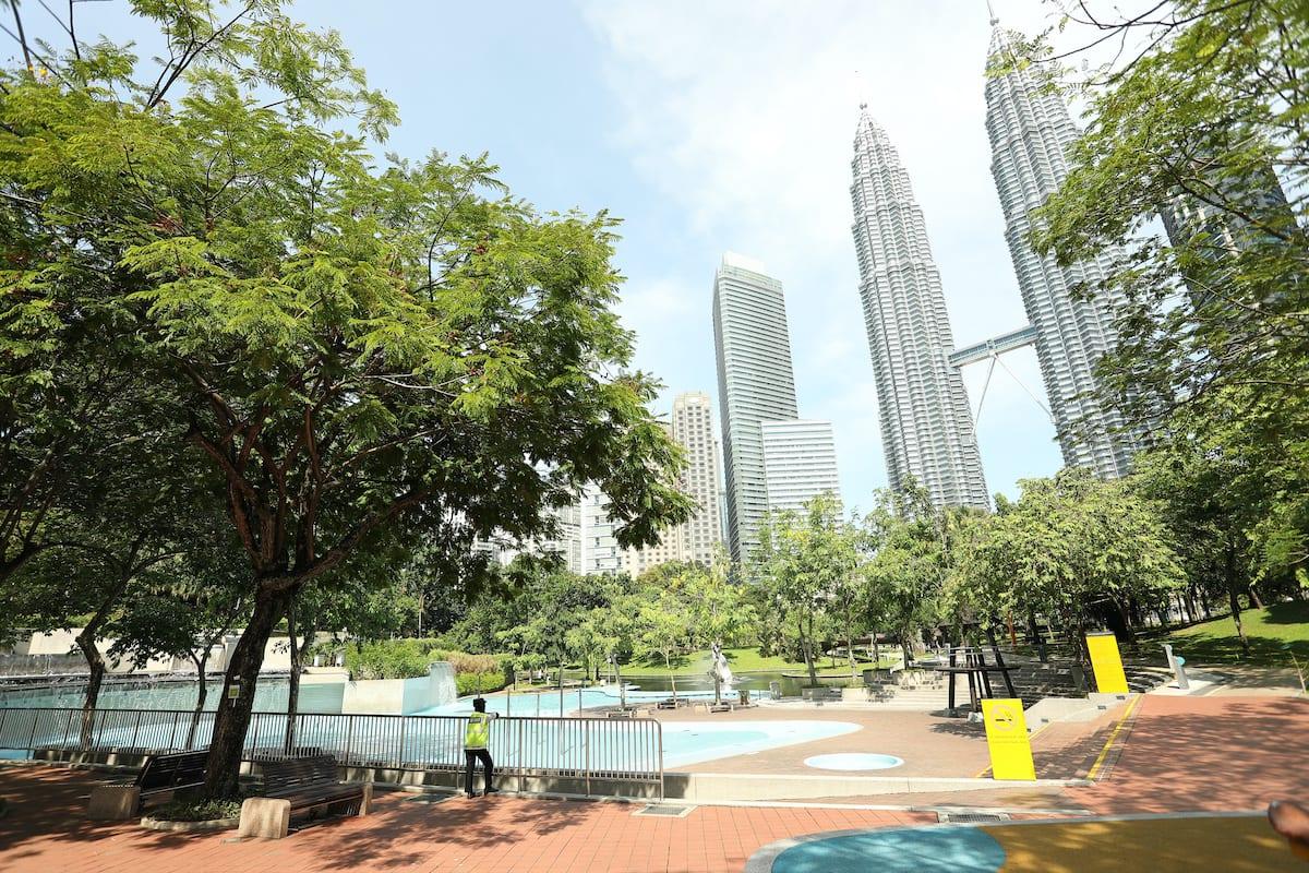 A view KLCC Twin Tower Neighbourhood is seen looks empty amid coronavirus fear in Kuala Lumpur, Malaysia on 17 March 2020. [Farid Bin Tajuddin - Anadolu Agency]
