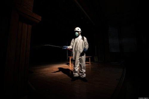 Members of the Syrian Civil Defence (White Helmets) disinfect public places as a preventive measure against coronavirus (Covid-19) pandemic in Idlib, Syria on 24 March 2020. [Muhammed Said - Anadolu Agency]