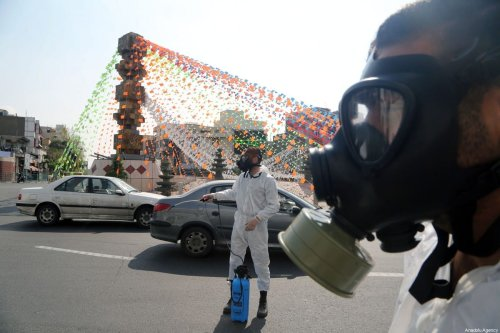 Iran's Revolutionary Guard Corps carry out disinfection works as a preventive measure against the coronavirus (Covid-19) pandemic ON 22 March 2020 [Fatemeh Bahrami/Anadolu Agency]