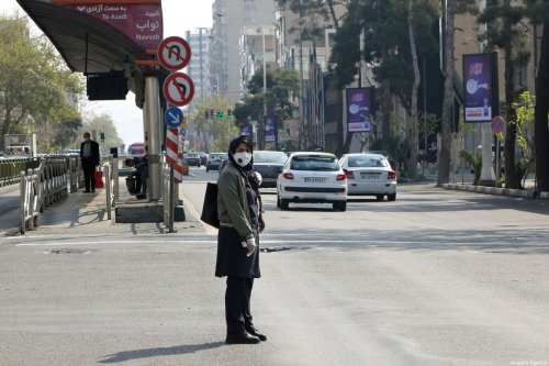 A woman wearing a face mask is seen at a nearly empty street during the coronavirus (COVID-19) outbreak in Tehran, Iran on March 25, 2020 [Fatemeh Bahrami / Anadolu Agency]