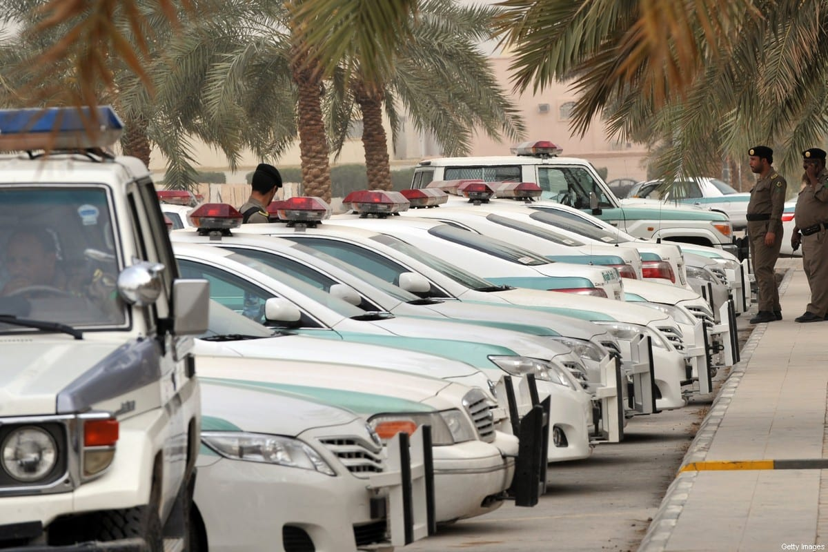 """Saudi police cars are parked and policemen stand guard in front of """"Al-rajhi mosque"""" in central Riyadh on March 11, 2011 [FAYEZ NURELDINE/AFP via Getty Images]"""