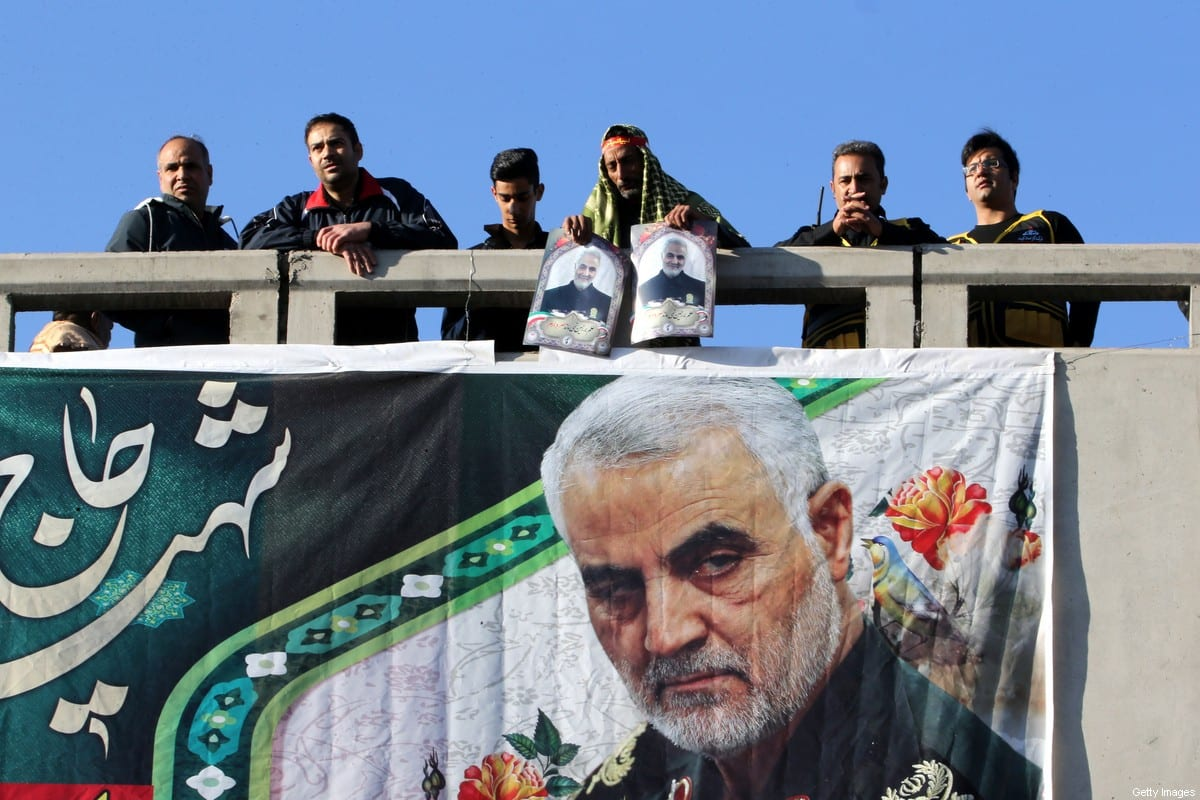 Iranian mourners stand on a bridge during the final stage of funeral processions for slain top general Qasem Soleimani, in his hometown Kerman on January 7, 2020. [ATTA KENARE/AFP via Getty Images]