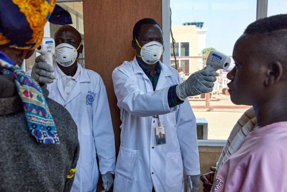 Passengers from an international flight are screened for their temperature in Sudan on 31 January, 2020 [ALEX MCBRIDE/AFP via Getty Images]