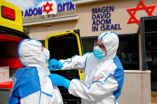 Israeli Paramedics gear up with protective clothing during a coronavirus response training exercise on 26 February 2020 [JACK GUEZ/AFP/Getty Images]