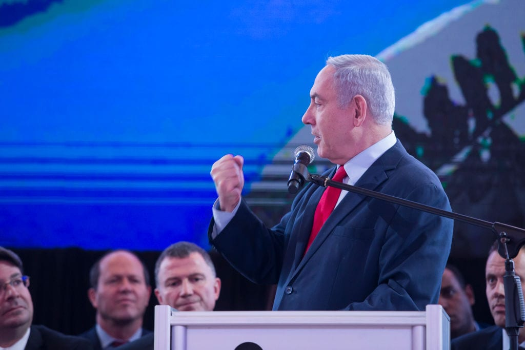 Israeli Prime Minister, Benjamin Netanyahu, delivers a statement to the press during a Likud Party meeting on 1 March, 2020 in the city of Lod, Israel [Amir Levy/Getty Images]
