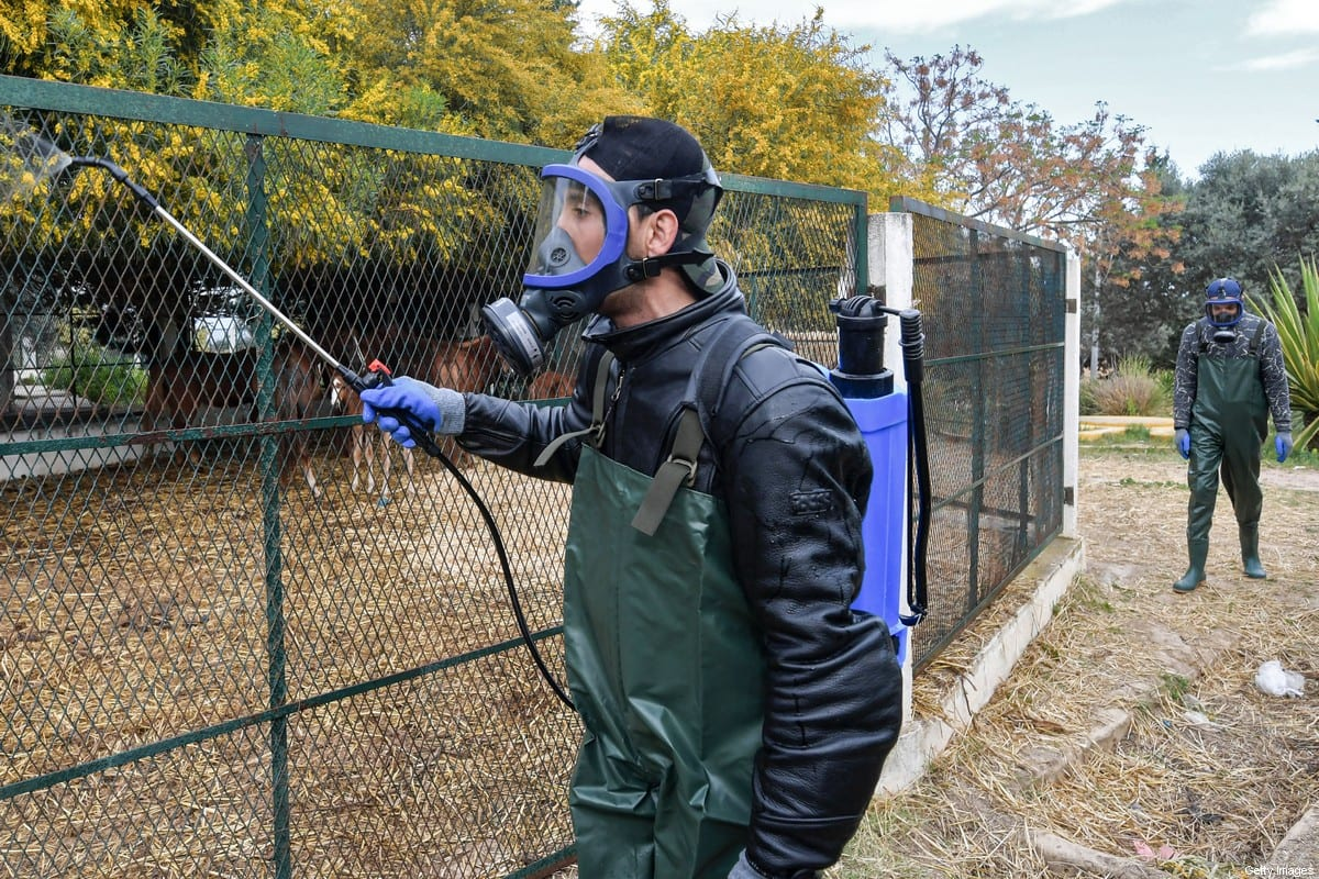 A health worker disinfects a horse pen at the Enahli amusement park on 16 March 2020 at Ariana near Tunis, which has been closed to the public from today during the coronavirus COVID-19 pandemic. [FETHI BELAID/AFP via Getty Images]