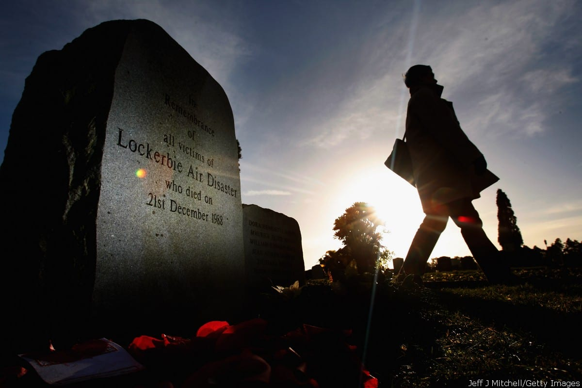 A member of the public visits the Lockerbie memorial on 17 December 2008 in Lockerbie, Scotland [Jeff J Mitchell/Getty Images)]