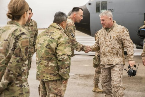 US Marine Corps Gen. Kenneth F. McKenzie Jr., the commander of U.S. Central Command, right, visits Airmen assigned to the 332 Air Expeditionary Wing, on 24 Jan 2020. [US Marine Corps/Sgt. Roderick Jacquote