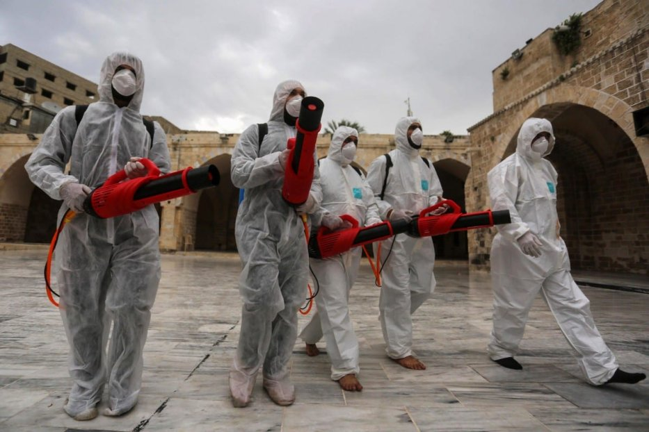Palestinian workers disinfect places of worship as a preventive measure amid fears of the spread of the novel coronavirus on 12 March 2020 [Ashraf Amra/ApaImages]